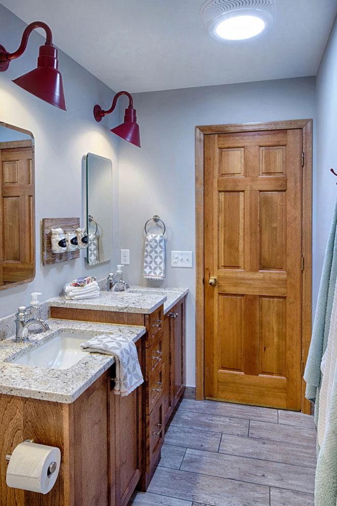 Double Sink bathroom with wooden door